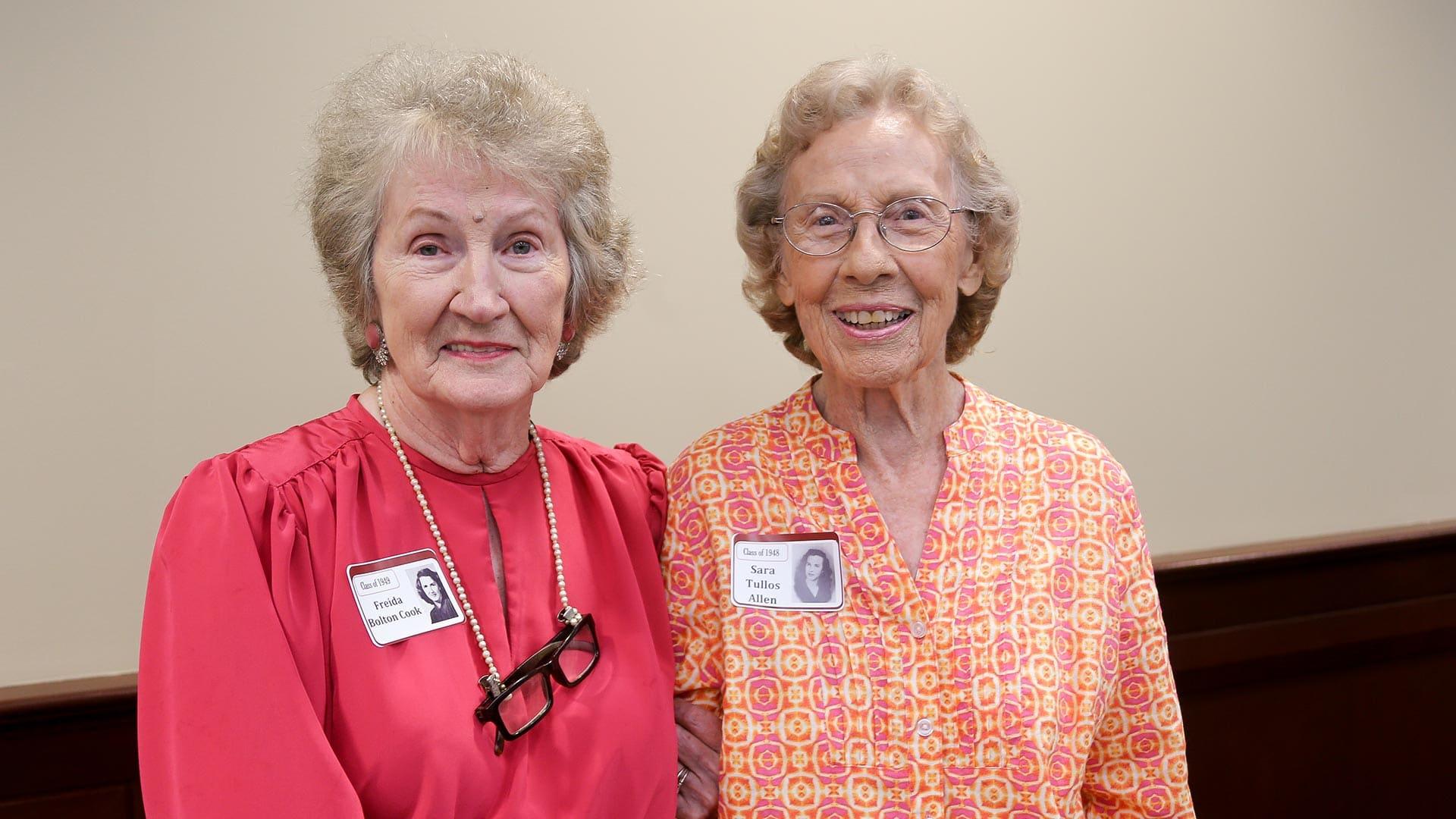 two female alumni